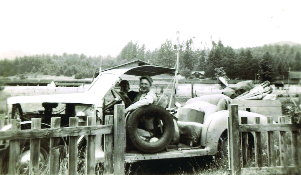"In the late 1940s, Brown (back) and his friend, Hugh Durrett (forefront), took a road trip in this car. The two traveled west in a ""great American adventure."""