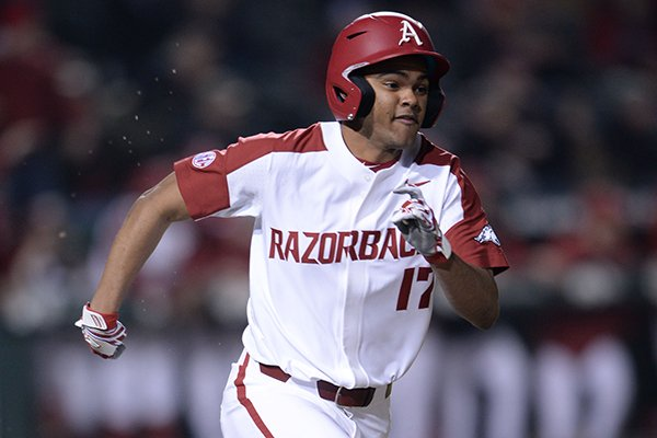 Arkansas freshman Trey Harris runs down the line after recording the go-ahead hit during a game against Louisiana Tech on Friday, March 8, 2019, in Fayetteville.