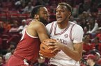 Arkansas forward Daniel Gafford tries to get past Alabama defender Galin Smith during the first half of an NCAA college basketball game, Saturday, March 9, 2019 in Fayetteville. (AP Photo/Michael Woods)