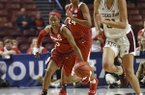 Arkansas' Malica Monk (3) and Taylah Thomas (24) bring the ball up the court past Texas A&M's N'dea Jones during the first half of an NCAA college basketball game in the Southeastern Conference women's tournament Saturday, March 9, 2019, in Greenville, S.C. (AP Photo/Richard Shiro)