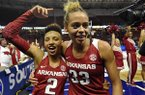 Arkansas' Chelsea Dungee, right, and Alexis Tolefree celebrate after defeating Texas A&M in an NCAA college basketball game in the Southeastern Conference women's tournament Saturday, March 9, 2019, in Greenville, S.C. (AP Photo/Richard Shiro)