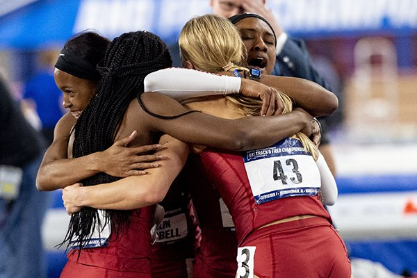 Arkansas' 1,600-meter relay team - (from left to right) Kethlin Campbell, Morgan Burks-Magee, Payton Chadwick and Kiara Parker - hug after realizing that the Razorbacks have won the women's team national championship at the NCAA Division I indoor athletics championships, Saturday, March 9, 2019, in Birmingham, Ala. (AP Photo/Vasha Hunt)