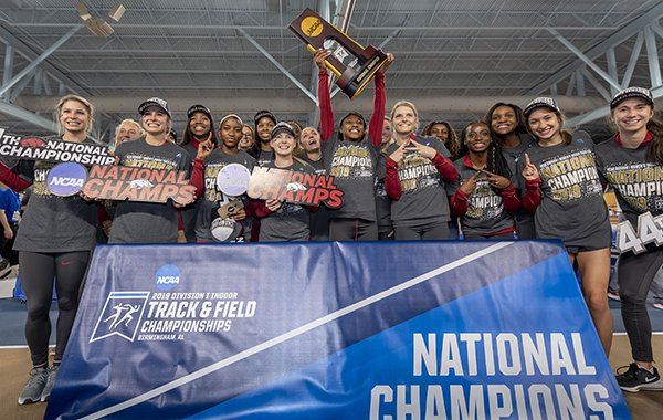 Arkansas hoists the women's national championship trophy after the NCAA Division I indoor athletics championships, Saturday, March 9, 2019, in Birmingham, Ala. (AP Photo/Vasha Hunt)