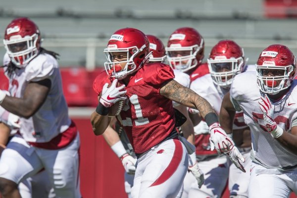 Devwah Whaley, Arkansas running back, carries in a scrimmage Saturday, March, 9, 2019, during spring practice at Razorback Stadium in Fayetteville.