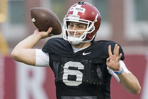 Arkansas quarterback Ben Hicks throws during practice Thursday, March 7, 2019, in Fayetteville.