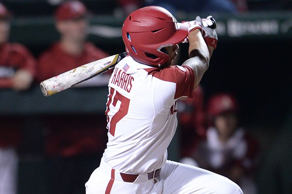Arkansas pinch hitter Trey Harris heads to first after hitting a two-run double against Louisiana Tech on Friday, March 8, 2019, during the seventh inning at Baum-Walker Stadium in Fayetteville.