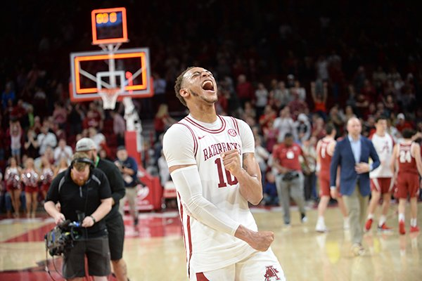 Arkansas forward Daniel Gafford celebrates at the final horn Saturday, March 9, 2019, during the Razorbacks' 82-70 win over Alabama in Bud Walton Arena in Fayetteville.
