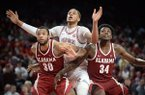 Arkansas center Daniel Gafford (middle) positions himself for a rebound between Alabama forwards Tevin Mack (34) and Galin Smith (30) during a game Saturday, March 9, 2019, in Fayetteville.