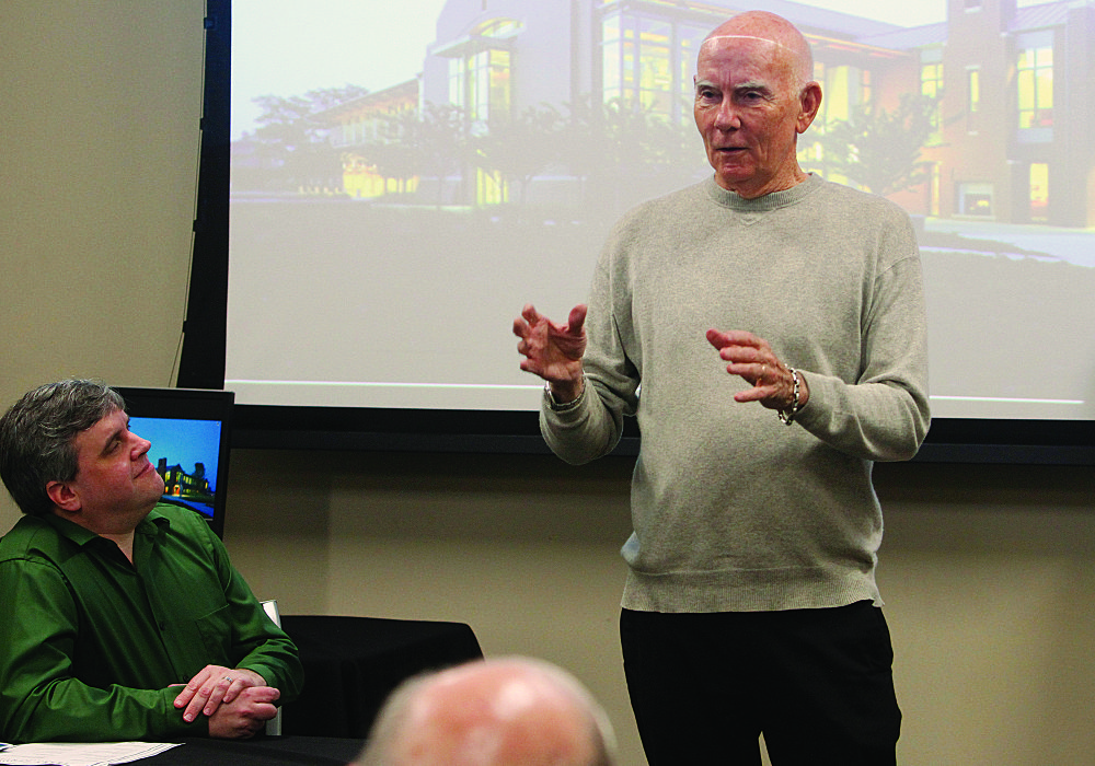 Lecture: Author and historian Ken Bridges, PhD, seated left, watches as businessman and fellow author Richard Mason lectures. Terrance Armstard/News-Times