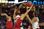 Arkansas's Chelsea Dungee, center, tries to grab a rebound while defended by Mississippi State's Teaira McCown, back, and Jordan Danberry, right, during the first half of an NCAA college basketball championship game in the Southeastern Conference women's tournament, Sunday, March 10, 2019, in Greenville, S.C. (AP Photo/Richard Shiro)