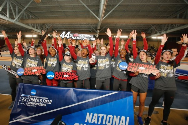 Arkansas celebrates after winning a national title at the NCAA Division I indoor championships on Saturday, March 9, 2019, in Birmingham, Ala.