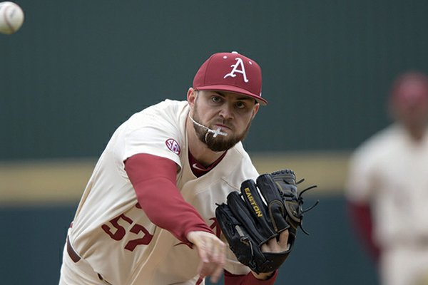 NWA Democrat-Gazette/Charlie Kaijo ALL BETTER: Arkansas Razorbacks Cody Scroggins (57) pitches during Sunday's game against Louisiana Tech at Baum-Walker Stadium in Fayetteville. Scroggins tore a ligament in his elbow two years ago against the Bulldogs, but he led the Razorbacks to an 11-0 win Sunday, striking out a career-high 11 in six innings on the mound.