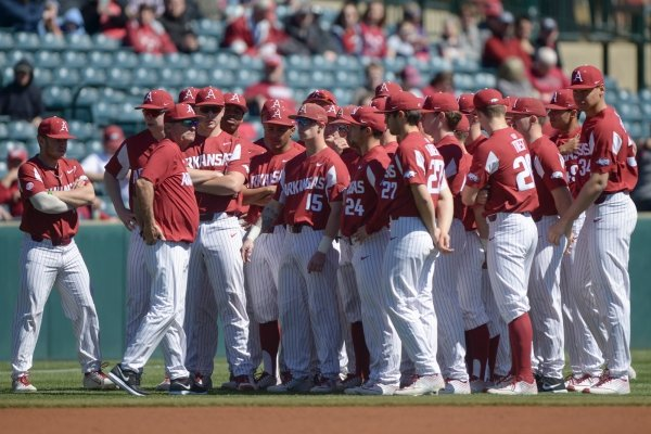 Arkansas Razorbacks players meet during a baseball game, Saturday, March 9, 2019 at Baum Stadium in Fayetteville.