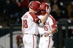 Arkansas shortstop Casey Martin (right) embraces outfielder Heston Kjerstad after Martin hit a home run during a game against Western Illinois on Tuesday, March 12, 2019, in Fayetteville.
