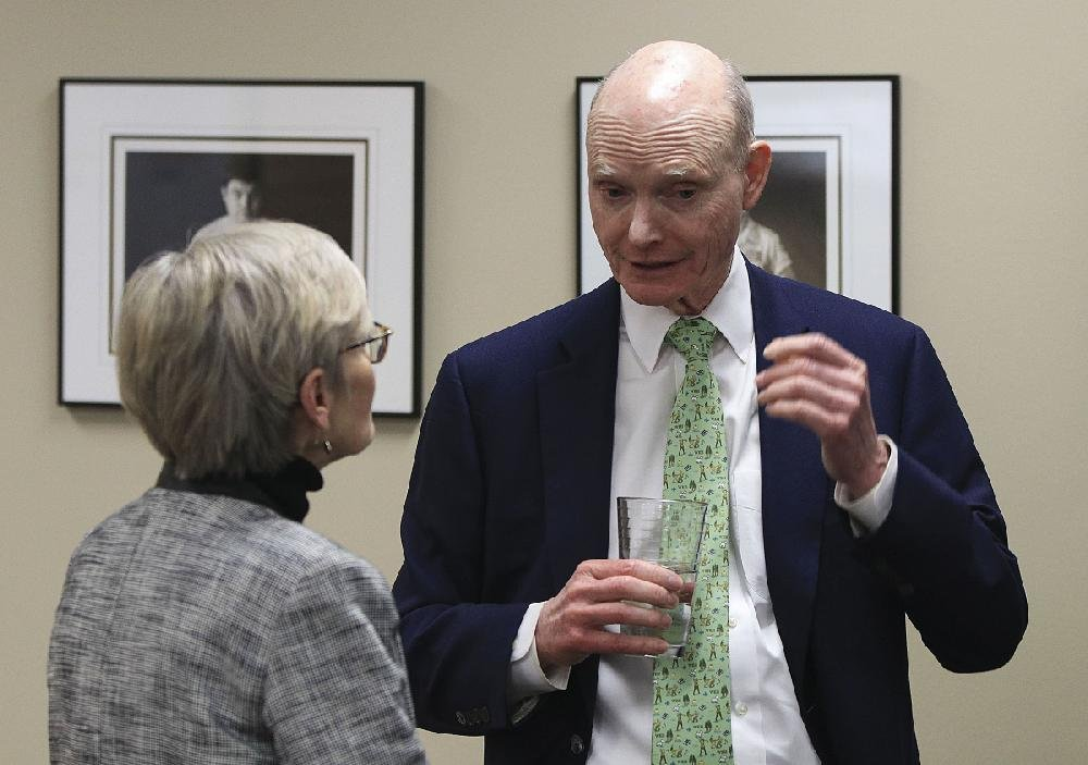 Walter E. Hussman Jr. talks with Easterseals Arkansas President and CEO Elaine Eubank after a news conference Tuesday during which Hussman was introduced as the organization's 2019 Arkansan of the Year.