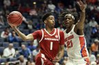 Arkansas guard Isaiah Joe (1) passes around Florida forward Dontay Bassett (21) in the first half of an NCAA college basketball game at the Southeastern Conference Tournament on Thursday, March 14, 2019, in Nashville, Tenn. (AP Photo/Mark Humphrey)