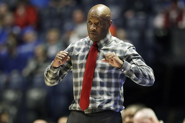 Arkansas head coach Mike Anderson signals to his players in the second half of an NCAA college basketball game against Florida at the Southeastern Conference tournament Thursday, March 14, 2019, in Nashville, Tenn. Florida won 66-50. (AP Photo/Mark Humphrey)
