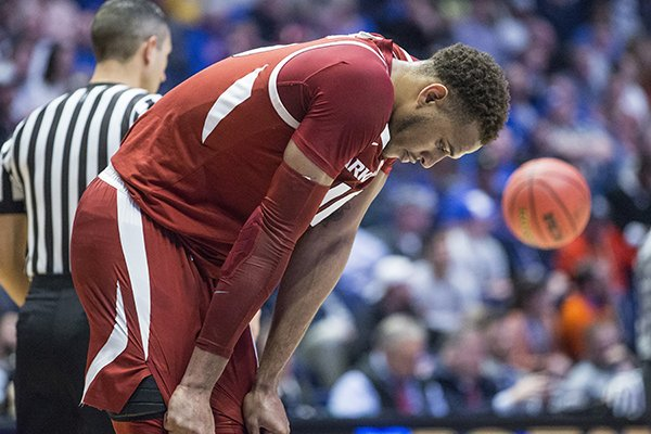 Arkansas center Daniel Gafford hangs his head late during the Razorbacks' SEC Tournament loss to Florida on Thursday, March 14, 2019, in Nashville, Tenn.