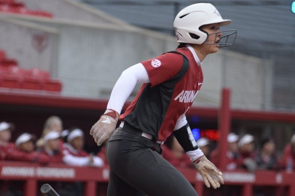 Arkansas catcher Kayla Green connects to score a run against Southeast Missouri Thursday, Feb. 21, 2019, during the first inning at Bogle Park on the university campus in Fayetteville.