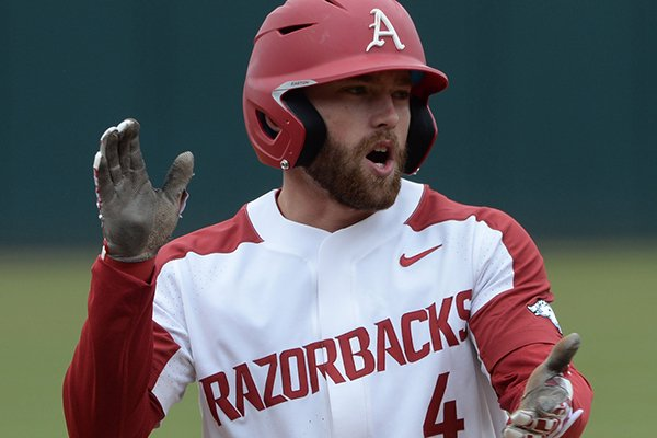 Arkansas first baseman Trevor Ezell celebrates Friday, March 1, 2019, after hitting a run-scoring triple during the sixth inning against Stony Brook in the first game of a doubleheader at Baum-Walker Stadium in Fayetteville.