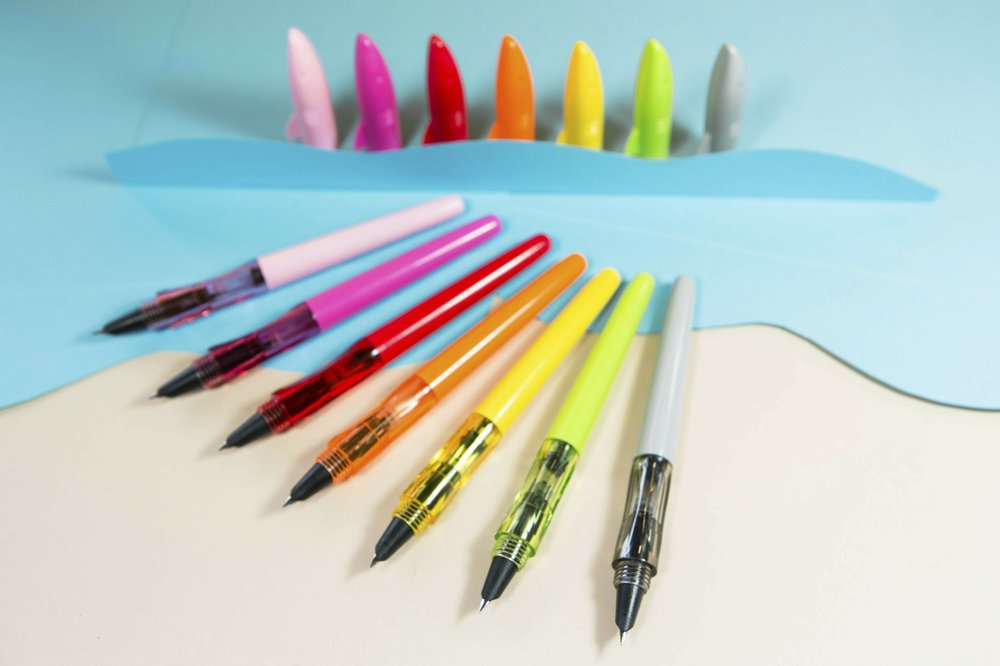This photo provided by The Goulet Pen Company shows Jinhao Shark Fountain Pens in assorted colors. In our computerized age, the old-fashioned fountain pen _ all jazzed up _ is making a surprise comeback. (Whitney Cole/The Goulet Pen Company via AP)
