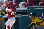 Arkansas left fielder Christian Franklin connects for a 2-run single against Missouri Saturday, March 16, 2019, during the fourth inning at Baum-Walker Stadium in Fayetteville. Visit nwadg.com/photos to see more photographs from the game.