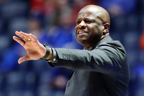 Arkansas head coach Mike Anderson yells to his players in the first half of an NCAA college basketball game against Florida at the Southeastern Conference tournament Thursday, March 14, 2019, in Nashville, Tenn. (AP Photo/Mark Humphrey)