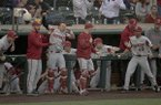 Arkansas players celebrate a grand slam against Texas during an NCAA college baseball game, Tuesday, March 19, 2019, in Austin, Texas. (Nick Wagner/Austin American-Statesman via AP)