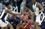 Arkansas' Gabe Osabuohien (22) struggles to keep control of the ball against Providence's David Duke (3) and Kalif Young (13) during the first half of a first round NCAA National Invitation Tournament college basketball game in Providence, R.I., Tuesday, March 19, 2019. (AP Photo/Michael Dwyer)