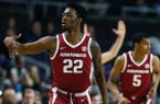 Arkansas' Gabe Osabuohien (22) reacts after making a three-pointer during the first half of a first round NCAA National Invitation Tournament college basketball game against Providence in Providence, R.I., Tuesday, March 19, 2019. (AP Photo/Michael Dwyer)