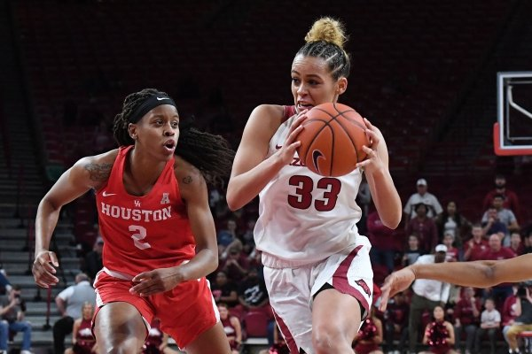 Arkansas' Chelsea Dungee drives to the basket between Houston's Octavia Barnes (LEFT) and Angela Harris Thursday March 21, 2019 at Bud Walton Arena in Fayetteville during the first round of the Women's National Invitational Tournament. Arkansas won 88-80 in overtime. The Razorbacks take on University of Alabama at Birmingham at home on Sunday.