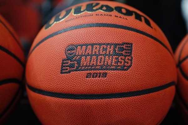 A basketball with a logo is seen before a first round men's college basketball game between Minnesota and Louisville in the NCAA Tournament, Thursday, March 21, 2019, in Des Moines, Iowa. (AP Photo/Charlie Neibergall)