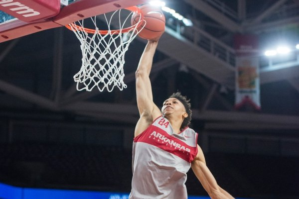 Ethan Henderson takes his turn in a slam dunk contest Friday, Oct. 19, 2018, before the Arkansas Red and White scrimmage at Bud Walton Arena in Fayetteville.