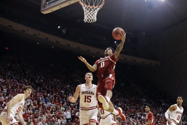 Arkansas's Desi Sills (0) puts up a shot against Indiana's Zach McRoberts (15) during the first half in the second round of the NIT college basketball tournament, Saturday, March 23, 2019, in Bloomington, Ind. (AP Photo/Darron Cummings)
