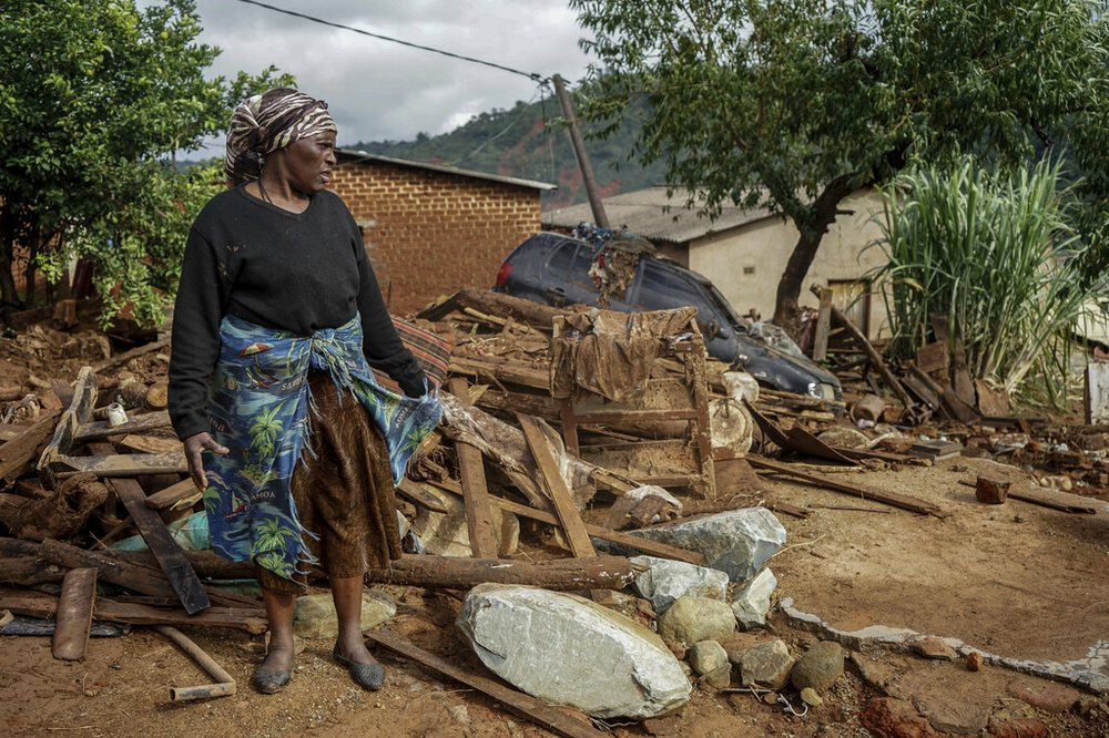 Jessica Mhonderi stands in front of what used to be her son's home in Chimanimani. Zimbabwe, Saturday, March 23, 2019. Mhonderi lost her daughter-in-law and three grandchildren to the Cyclone Idai induced rains last week that swept through Mozambique, Zimbabwe and Malawi.