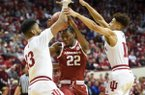 Arkansas Razorbacks forward Gabe Osabuohien (22) defends the ball from Indiana Hoosiers forward Juwan Morgan (13) and guard Rob Phinisee (10) during the first half of the NCAA National Invitation Tournament, Saturday, March 23, 2019 at the Simon Skjodt Assembly Hall at the University of Indiana in Bloomington, Ind. The Arkansas Razorbacks fell to the Indiana Hoosiers 63-60.