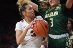 Arkansas' Chelsea Dungee drives to the basket while UAB's Angela Vendrell defends during a WNIT game Sunday, March 24, 2019, at Bud Walton Arena in Fayetteville.