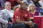 Arkansas basketball coach Mike Anderson watches practice, while athletics director Hunter Yurachek looks on in the background during the Razorbacks' Red-White Game on Friday, Oct. 19, 2018, in Fayetteville.