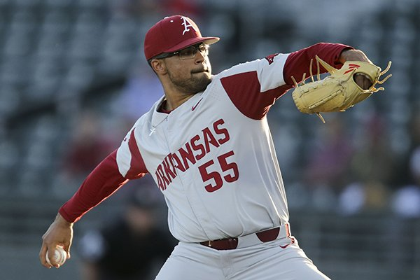 Arkansas pitcher Isaiah Campbell (55) delivers against Alabama during an NCAA college baseball game in Tuscaloosa, Ala., Friday, March 22, 2019. (Gary Cosby Jr./The Tuscaloosa News via AP)