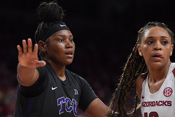 TCU's Amy Okonkwo is guarded by Arkansas' Kiara Williams during a third round WNIT game Thursday, March 28, 2019, in Fayetteville.