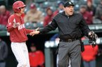 Arkansas third baseman Jacob Nesbit argues a call with home plate umpire Eddie Newsom during a game Saturday, March 30, 2019, in Fayetteville.