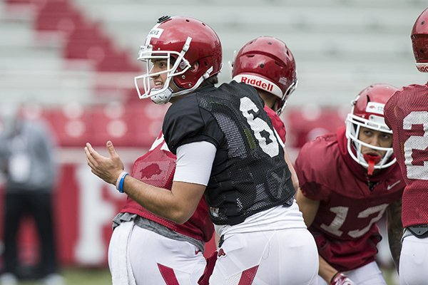 Arkansas quarterback Ben Hicks talks to teammates during practice Saturday, March 30, 2019, in Fayetteville.
