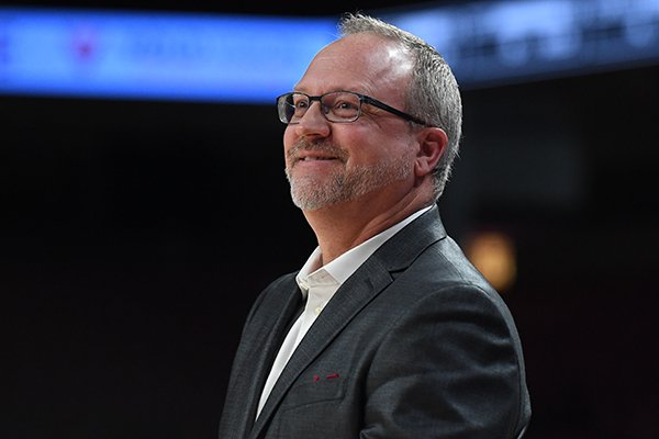 Arkansas coach Mike Neighbors smiles during a WNIT third round game Thursday, March 28, 2019, in Fayetteville.