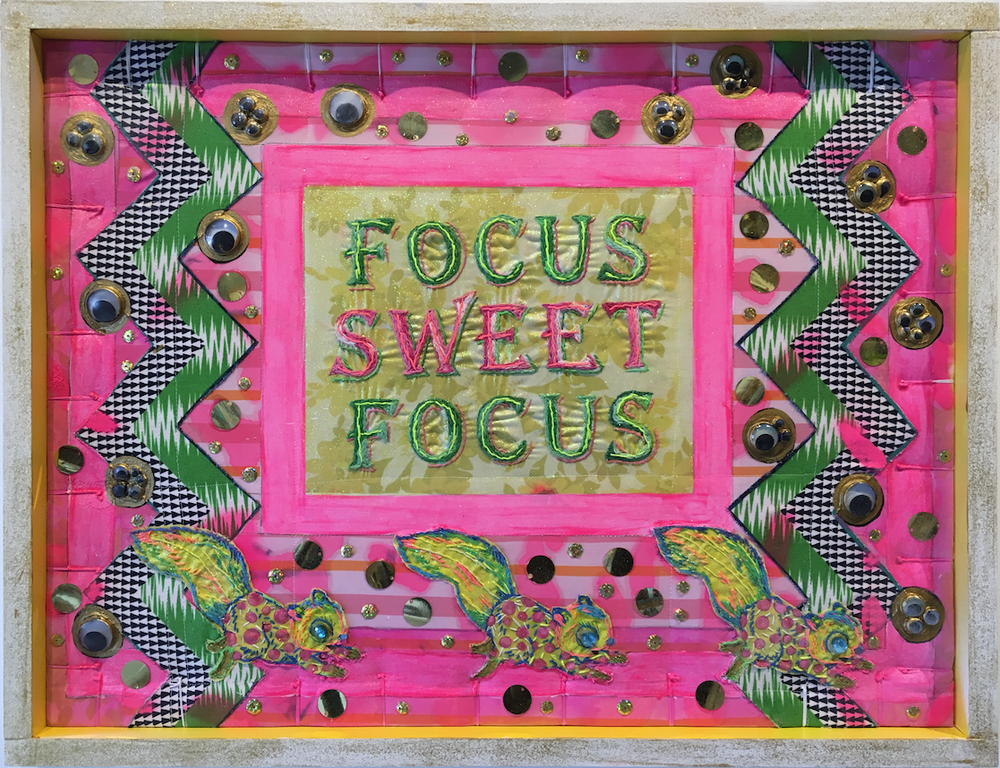 "The message is clear on Amanda Linn's ""Post Modern Comfort #1,"" a work of vintage fabric, embroidery floss, acrylic paint, glitter and miscellaneous craft items. (Courtesy of Gallery 26)"