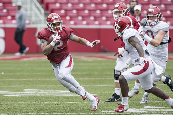 Arkansas running back Chase Hayden (2) carries the ball during practice Saturday, March 30, 2019, in Fayetteville.