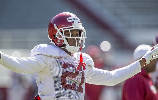 Arkansas defensive back Montaric Brown goes through warmups prior to practice Saturday, March 9, 2019, in Fayetteville.