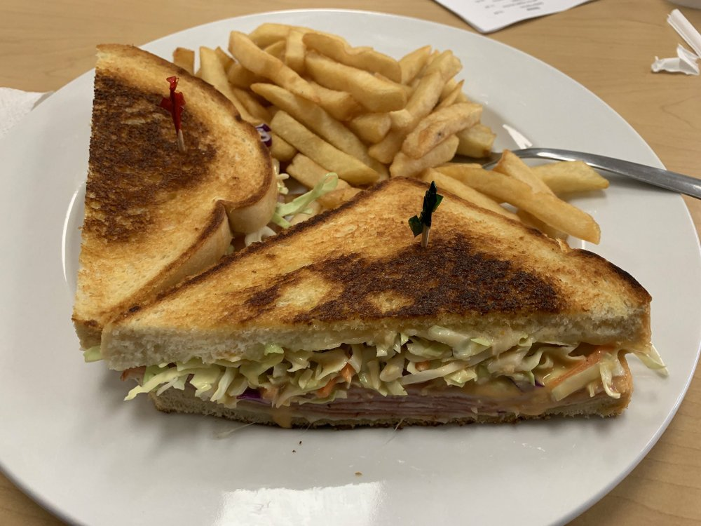 "The ""Ruben"" comes with slaw instead of sauerkraut and a side of fries at Malibu Cafe on Louisiana Street. Arkansas Democrat-Gazette/Eric E. Harrison"