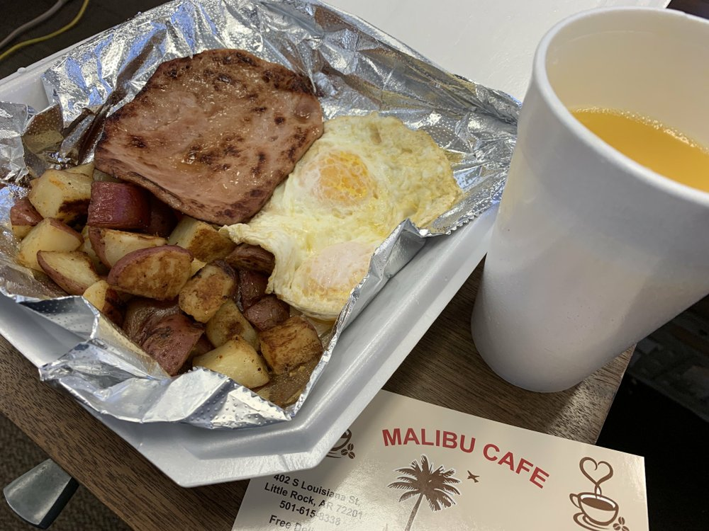 "A to-go order of ""Smoke Ham & Eggs"" from Malibu Cafe came with red-skin potatoes and orange juice but without the promised slice of wheat or white bread. Arkansas Democrat-Gazette/Eric E. Harrison"