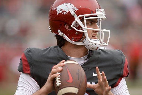 Arkansas quarterback Ben Hicks warms up Saturday, April 6, 2019, before the start of the Razorbacks' spring game in Razorback Stadium in Fayetteville.