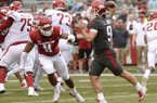 Arkansas quarterback John Stephen Jones (9) rolls out to pass Saturday, April 6, 2019, as defensive lineman Mataio Soli (11) defends during the Razorbacks' spring game in Razorback Stadium in Fayetteville.